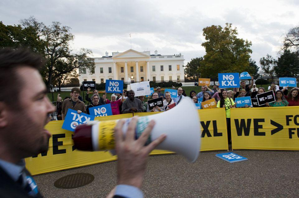 Demonstrators celebrate then-U.S. president Barack Obama's blocking of the Keystone XL oil pipeline in...
