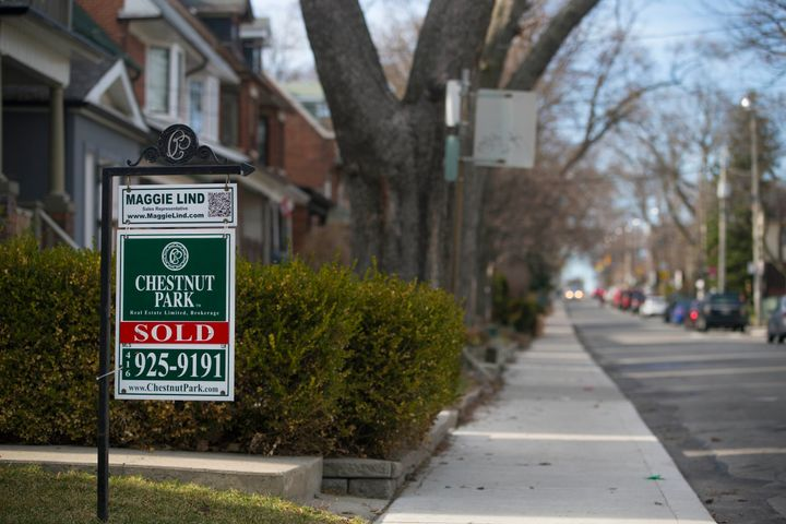 A house for sale in a Toronto neighbourhood, April 2015. The Ontario government is encouraging potential homeowners to consider co-ownership as a way of getting into the housing market.