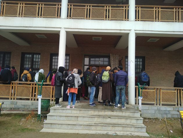Kashmiri students waiting to fill the online application for the NEET medical entrance exam in the midst...