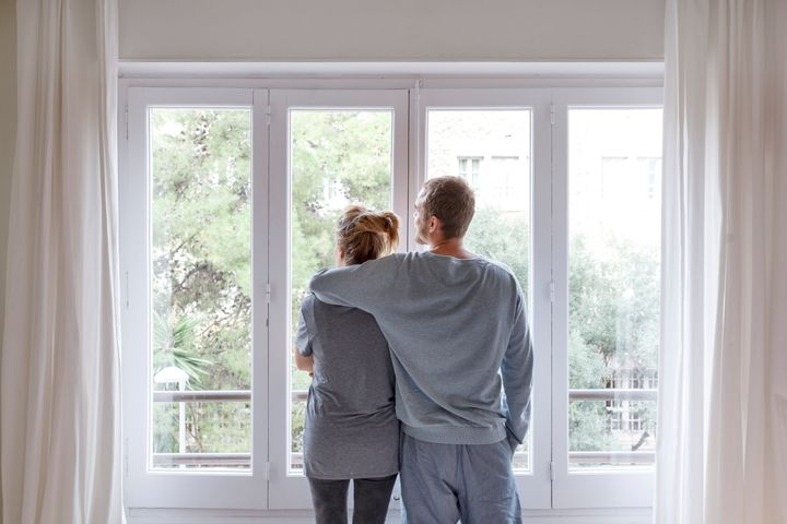 A man wraps his arm around his partner in this stock image. Co-ownership could be a great way for couples to get into the market, especially if they can't afford a down payment on their own.