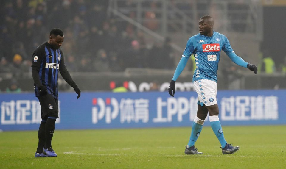 Napoli's Kalidou Koulibaly leaves the pitch after receiving a red card from the referee during a Serie...