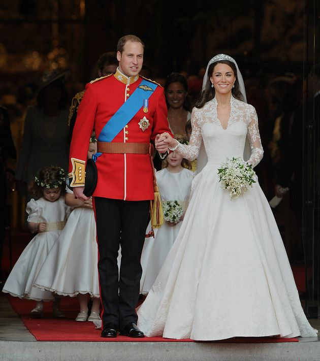 Prince William and his wife Kate, Duchess of Cambridge, emerge from Westminster Abbey, newly