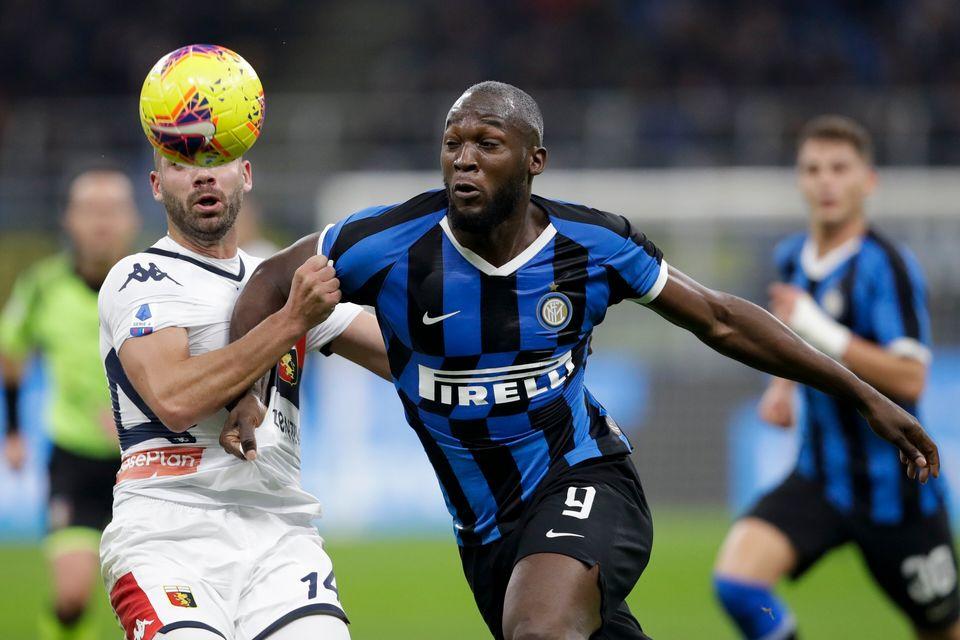 Inter Milan's Romelu Lukaku, foreground right, and Genoa's Davide Biraschi vie for the ball during a...