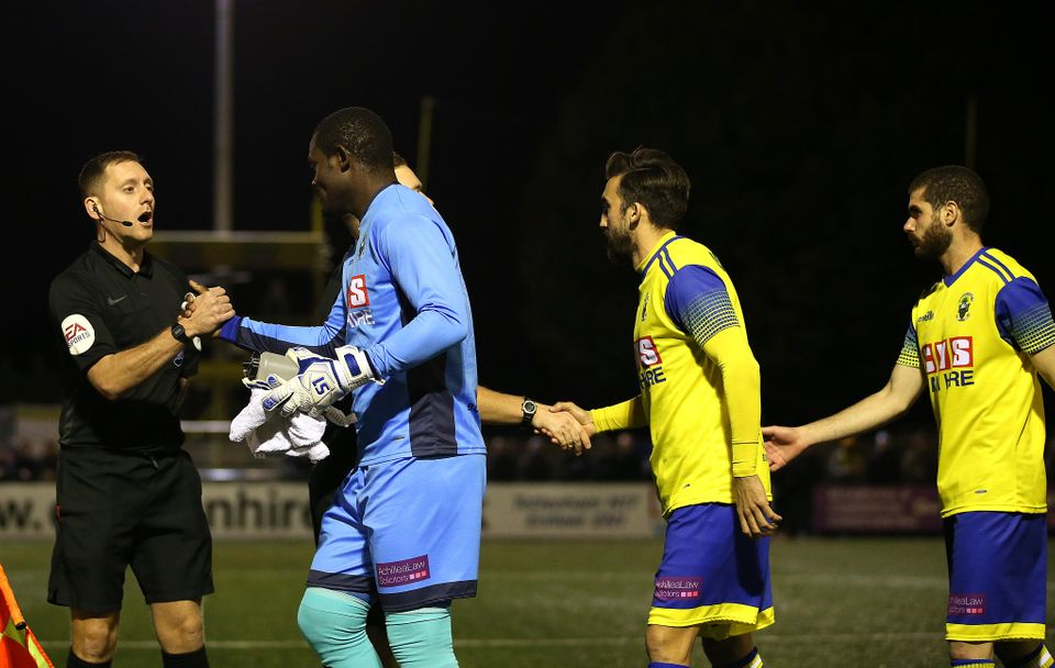 Haringey Borough goalkeeper Valery Pajetat (left) walks out onto the pitch at the start of the FA Cup...