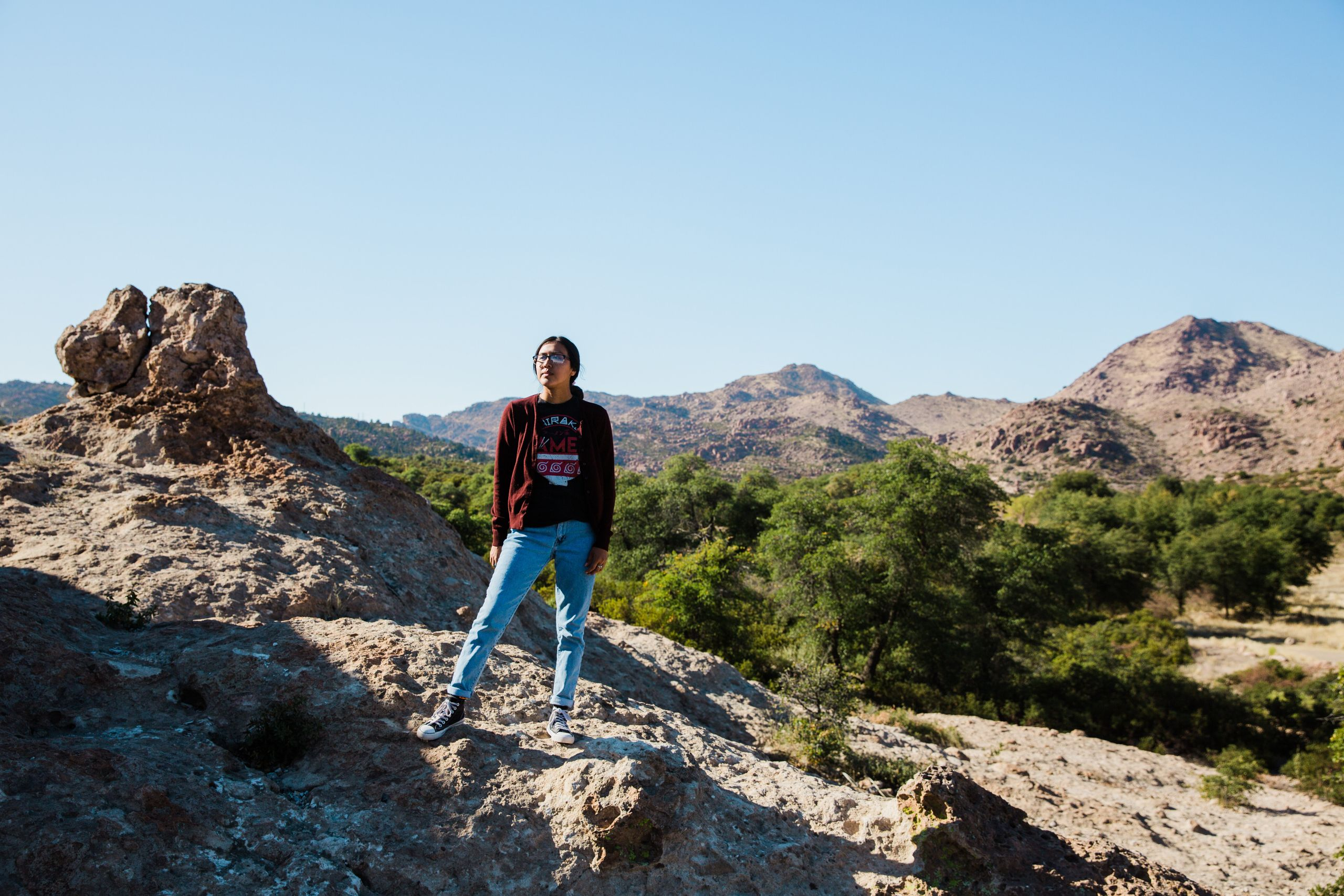 Naelyn Pike, 20, a co-leader of Apache Stronghold, stands overlooking sacred land at Chich'il Bildagoteel (Oak Flat) ancestra