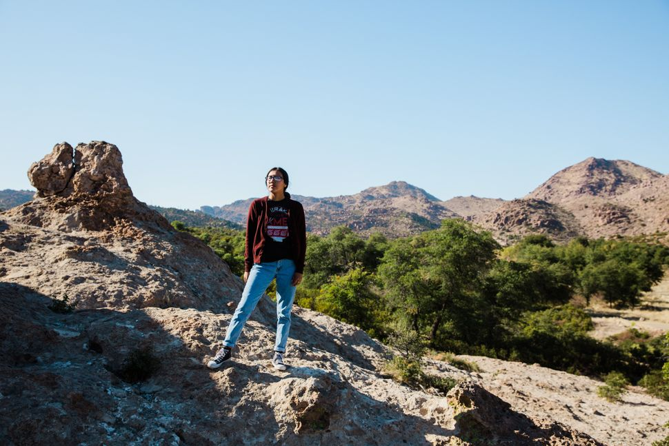 Naelyn Pike, 20, a co-leader of Apache Stronghold, stands overlooking sacred land at Chich'il Bildagoteel...