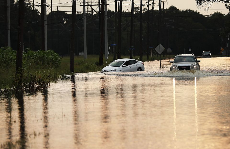 A truck drives through high water on a street as Orange, Texas, slowly moves toward recovery almost a...
