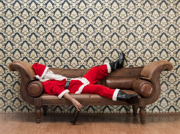 Drunk Santa Claus lying on