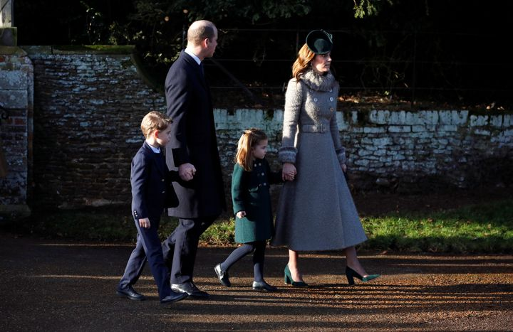 Prince William, Catherine, Duchess of Cambridge, Prince George and Princess Charlotte leave the St Mary Magdalene's church on December 25, 2019.