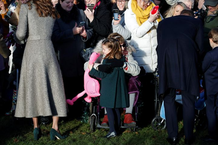 Princess Charlotte hugs a well-wisher after being given a gift following the royal Christmas service on Dec. 25, 2019.