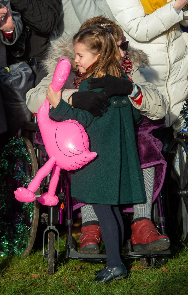 Gemma Clark from Lincolnshire hugs Charlotte after the Christmas Day morning church service at St Mary Magdalene Church in Sa