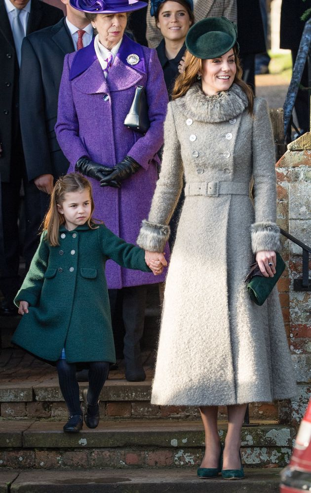 Princess Charlotte curtsies to the queen as she attends the Christmas Day church service at the Church...