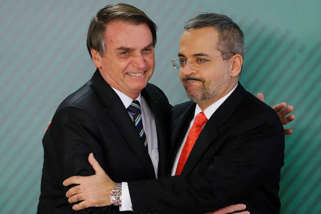 Brazil's President Jair Bolsonaro greets new Education Minister Abraham Weintraub during his inauguration...
