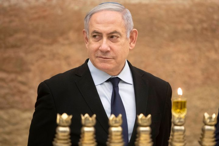 Israeli Prime Minister Benjamin Netanyahu looks on after lighting a Hanukkah candle at the Western Wall on Dec. 22, 2019.