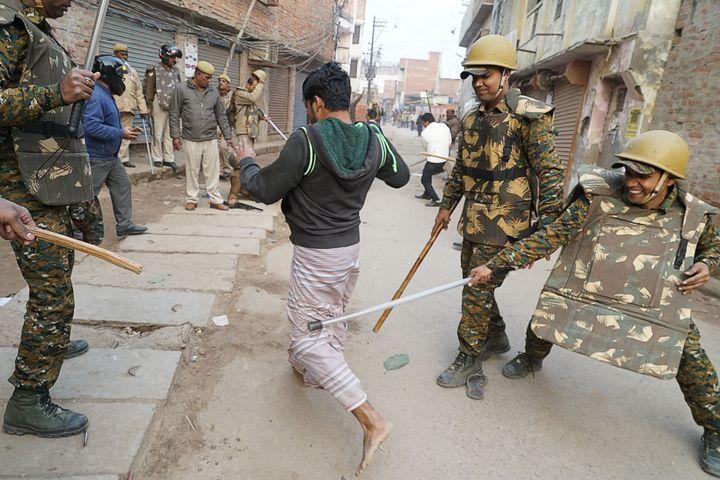 Police in Varanasi, Uttar Pradesh beat a man during protests against the CAA on December 20, 2019.