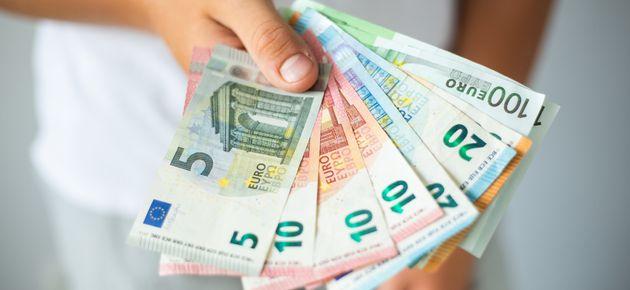 Man hands holding euro banknotes. Selective