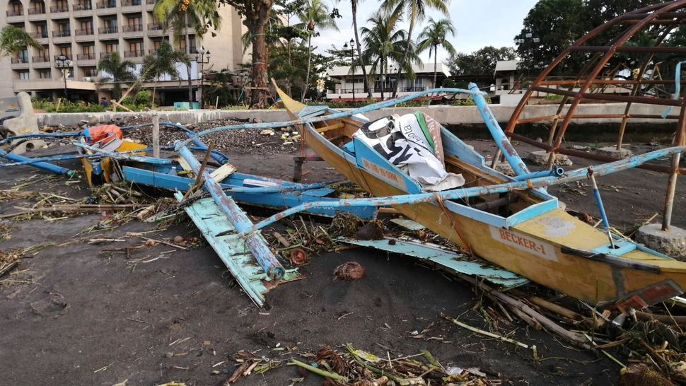 An outrigger boat destroyed by the storm in Ormoc City, central Philippines. The typhoon left over a dozen dead and many home