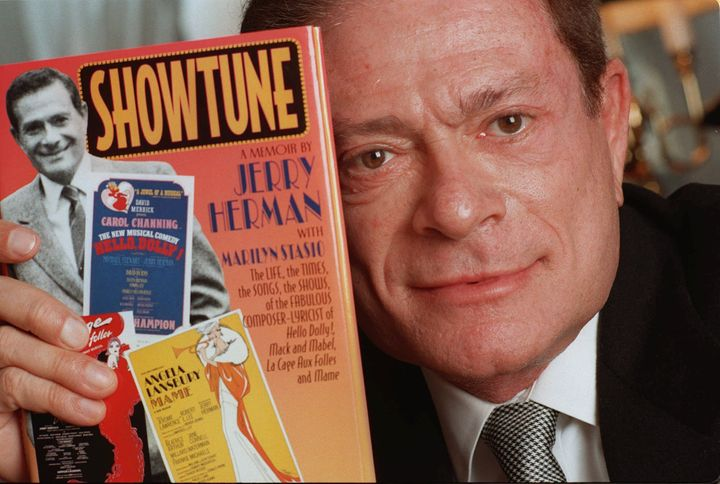 """Composer Jerry Herman, seen in this 1996 file photo, displays his book """"Showtune."""""""