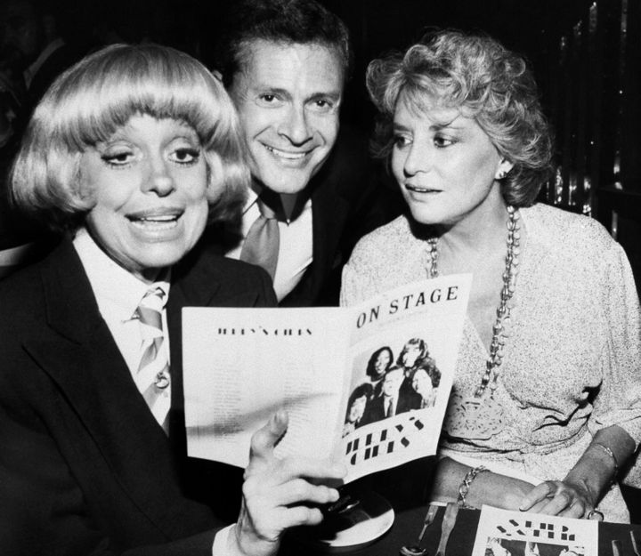 In this 1981 file photo, Carole Channing, left, and TV personality Barbara Walters look over the program with Herman at a Bro