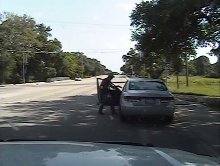 Texas state trooper Brian Encinia points a Taser at Sandra Bland during a traffic stop in this still image captured from his