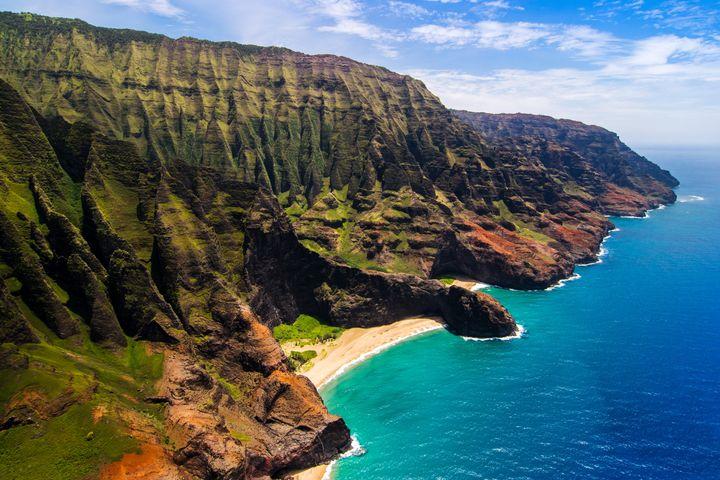 The Na Pali Coast spans over 15 miles of undeveloped coastline on the northwestern coast of the Hawaiian island of Kauai.