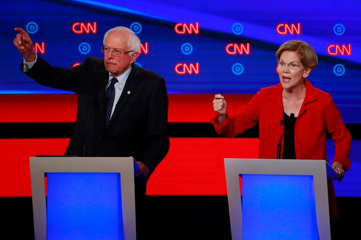 Bernie Sanders, left, and Elizabeth Warren have argued for Medicare for All on the debate stage. But the health care industry