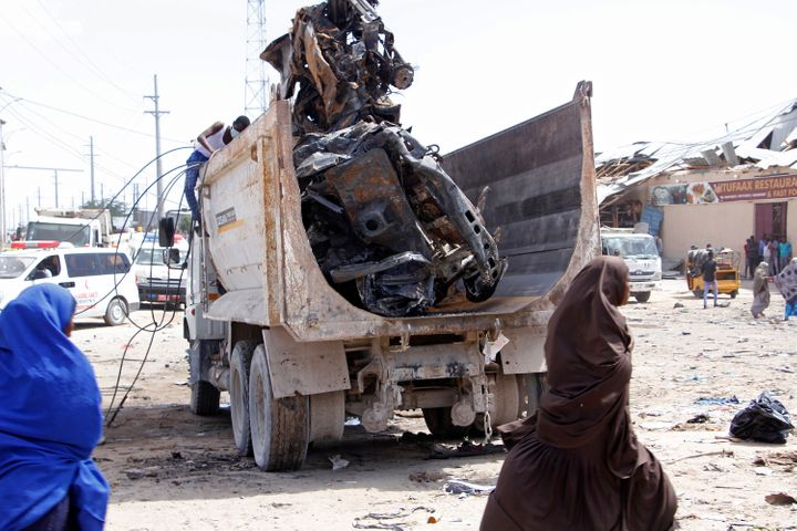 A truck carries wreckage of a car used in a car bomb in Mogadishu, Somalia, Saturday, Dec. 28, 2019.