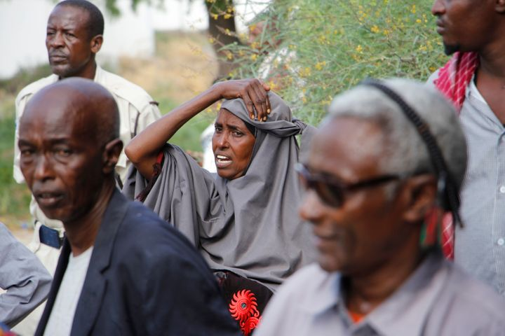 A mother waits outside hospital to hear news of her son after a car bomb in Mogadishu, Somalia, Saturday, Dec. 28, 2019.