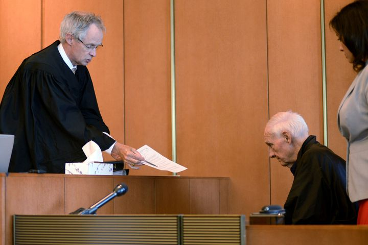 FILE - In this Monday, Aug. 10, 2015 file photo, Judge Timothy Feeley, left, addresses former the Rev. Richard J. McCormick,
