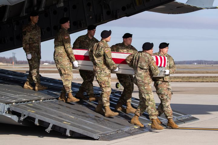 Dec. 25, 2019 - An Army carry team moves a transfer case containing the remains of U.S. Army Sgt. 1st Class Michael Goble, at