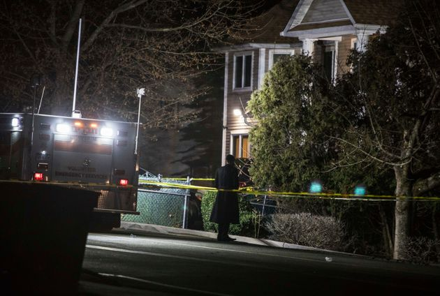 An Orthodox Jewish man stands in front of a residence in Monsey, New York, following a stabbing late...
