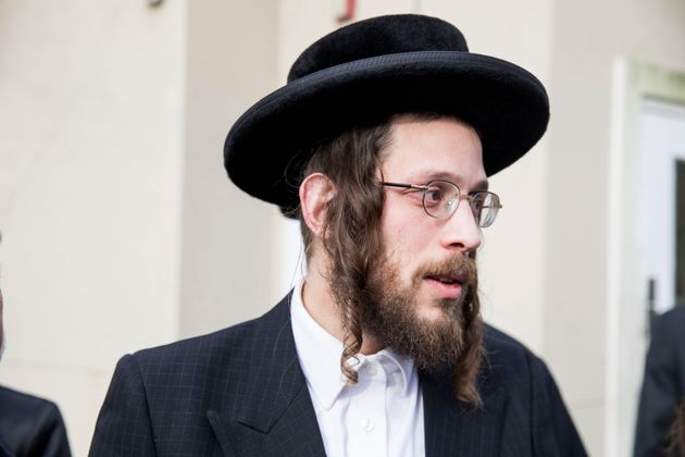Josef Gluck talks to members of the media about how he obstructed the attacker Saturday night at a rabbi's