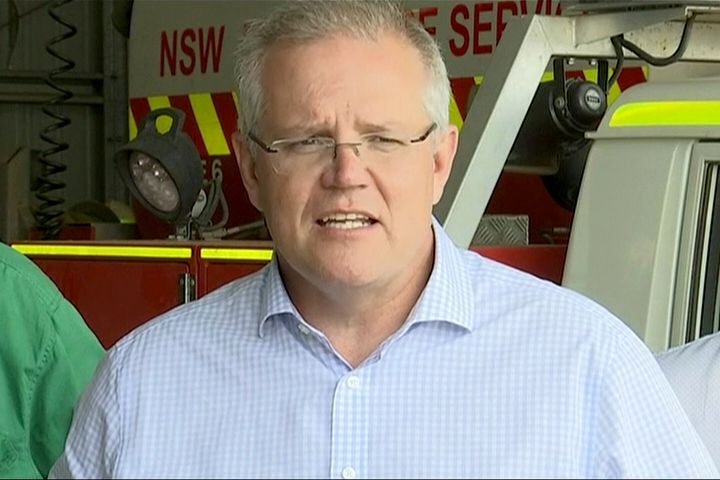 In this image made from video, Australia's Prime Minister Scott Morrison speaks to firefighters in Mudgee, New South Wales Monday, Dec. 23, 2019. Morrison on Monday praised emergency service workers for their efforts to combat fires which raged throughout New South Wales. (Australian Pool via AP)