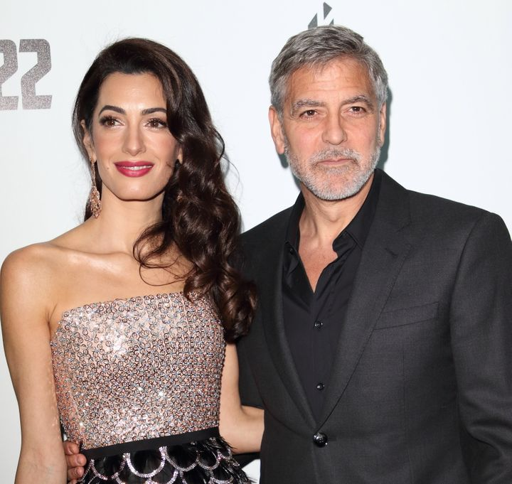 "Amal Clooney and George Clooney at the series premiere of ""Catch 22"" in London."