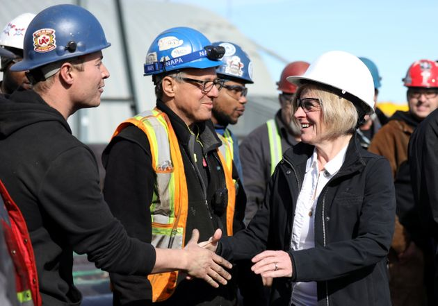 Rachel Notley greets workers during a campaign event at Nardei Fabricators in Calgary on Apr. 15,