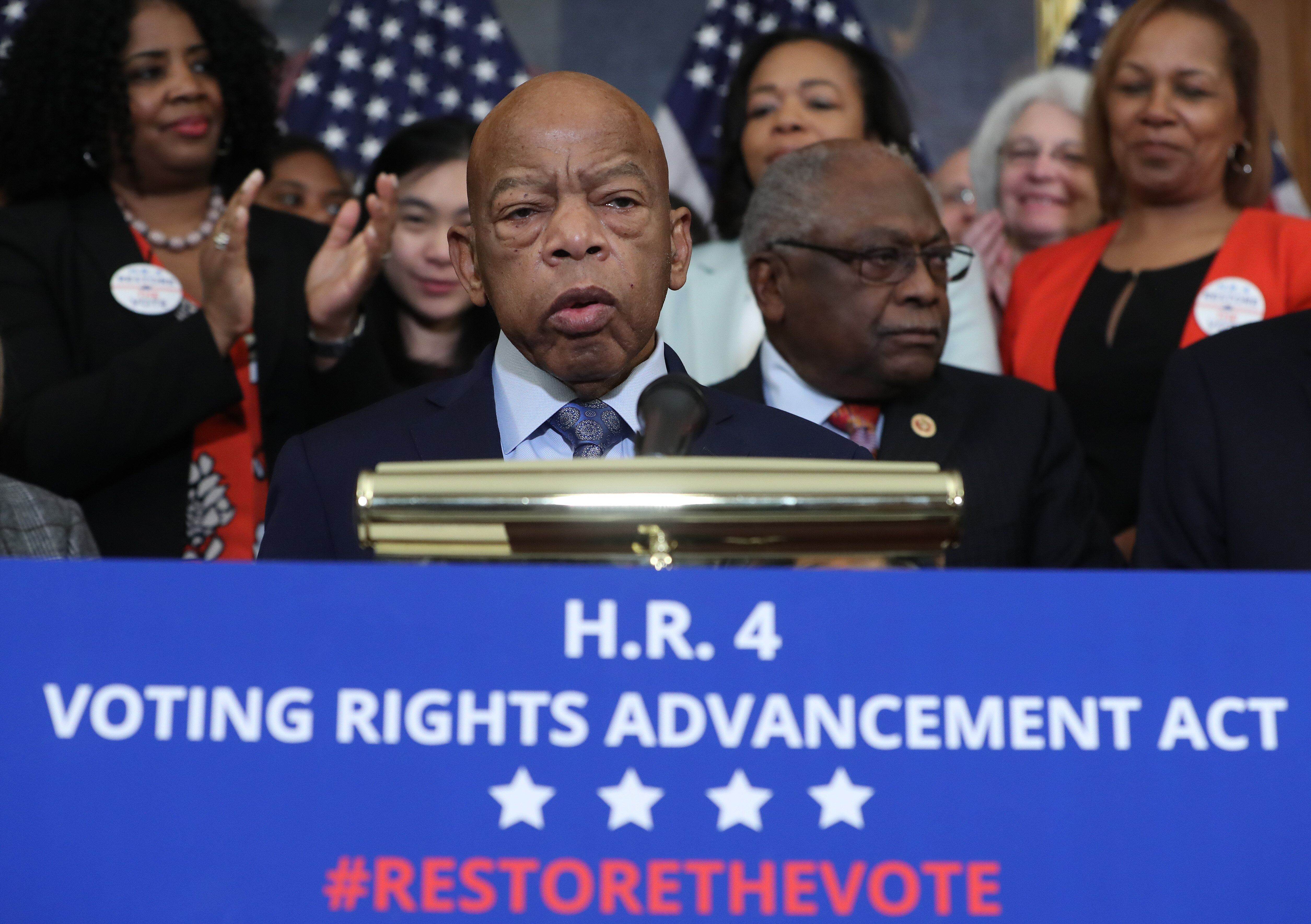Lewis speaks to the media ahead of the House vote on the Voting Rights Advancement Act on Dec. 6, 2019. The bill would restore the full strength of the Voting Rights Act after a 2013 Supreme Court decision gutted it, unleashing widespread voter suppression.