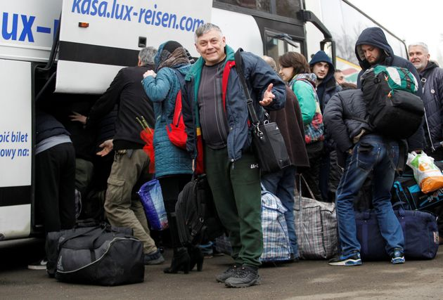 Prisoners of war get off a bus after they were released by Ukrainian authorities and exchanged during...