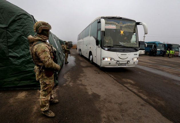 A bus transporting Ukrainian citizens arrives at the checkpoint of the Ukrainian armed forces following...