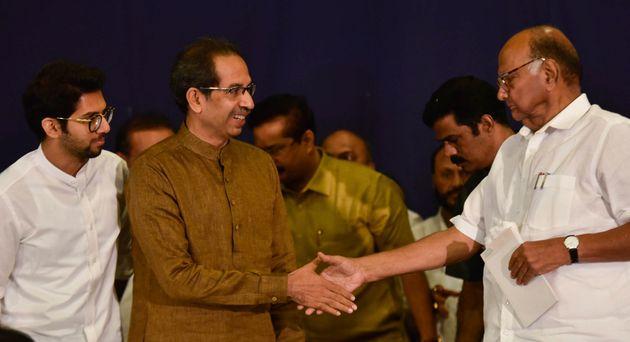 Shiv Sena Chief and Maharashtra CM Uddhav Thackeray, NCP chief Sharad Pawar and Aditya Thackarey during...