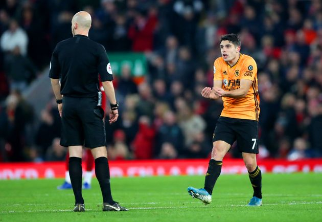 Wolverhampton Wanderers' Pedro Neto (right) appeals to Referee Anthony Taylor as VAR disallows his goal...