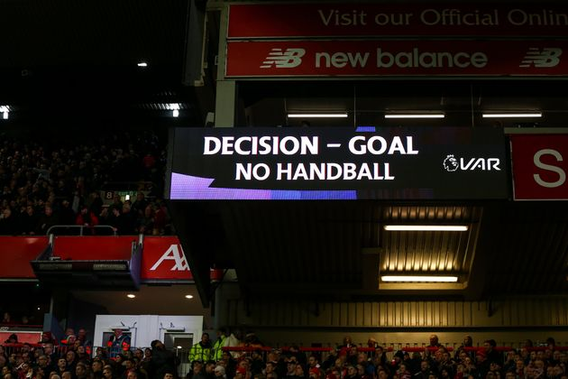 LIVERPOOL, ENGLAND - DECEMBER 29: An LED screen shows the VAR decision to award Liverpool a goal to make...