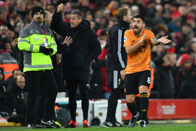 Wolverhampton Wanderers' Portuguese midfielder Ruben Neves gestures after VAR confirms the opening goal...