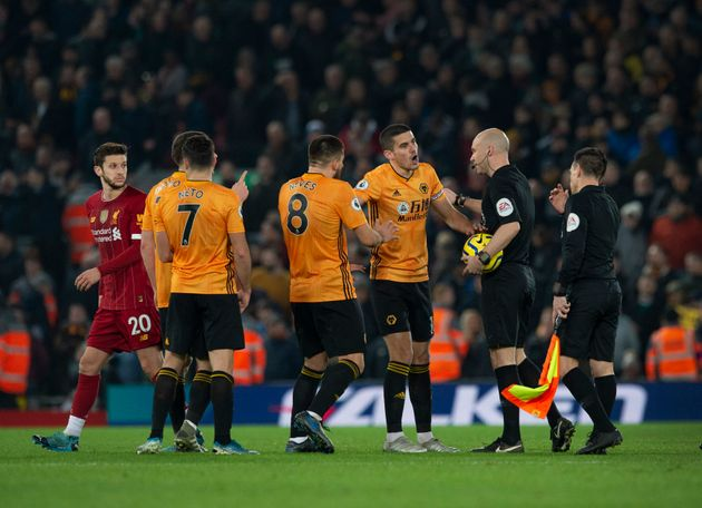 LIVERPOOL, ENGLAND - DECEMBER 29: Wolverhampton Wanderers players complain to referee Anthony Taylor...