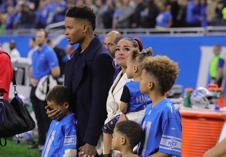 Marvin Jones and his family stand on the sideline in a moment of silence for his infant son, Marlo.