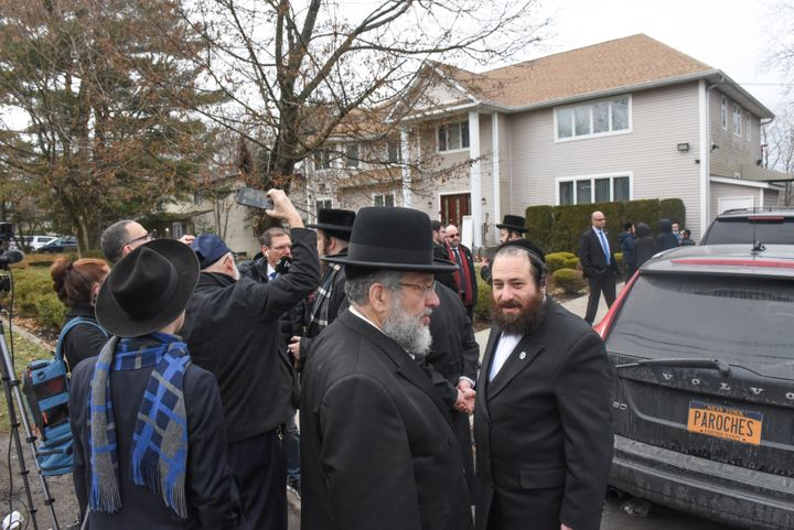 Members of Rabbi Chaim Rottenberg's community gather in front of the house of Rabbi Chaim Rottenberg on December 29, 2019 in