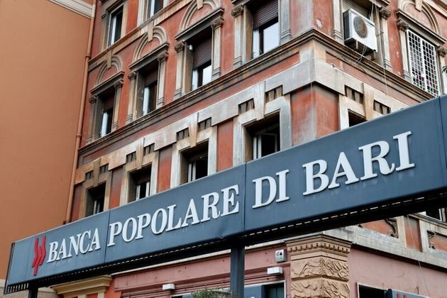 FILE PHOTO: The logo of Banca Popolare di Bari bank is pictured outside the company's branch after...