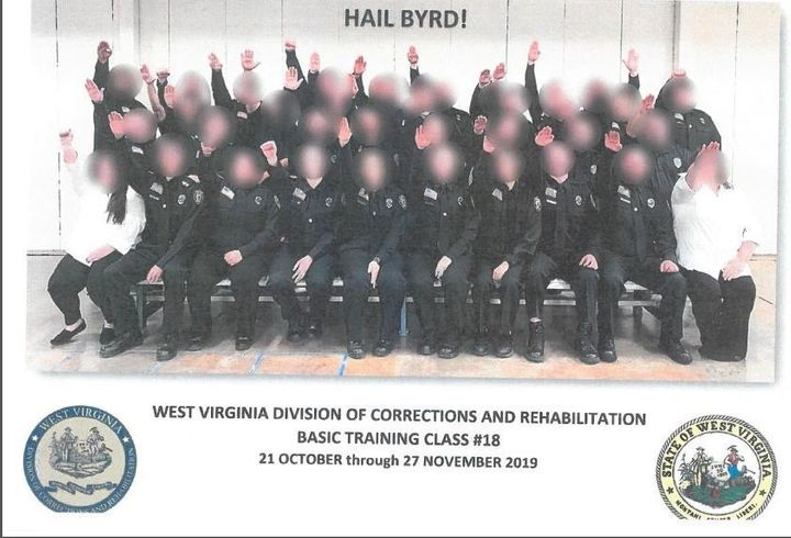 Government employees working for West Virginia's Division of Corrections and Rehabilitation make a Nazi salute in a class pho