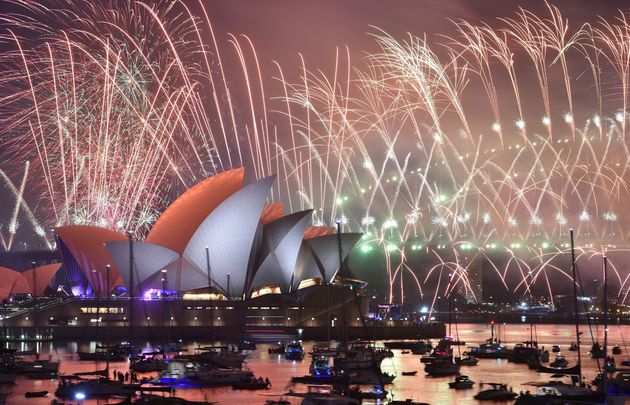 New Year's Eve fireworks erupt over Sydney's iconic Harbour Bridge and Opera House during the fireworks...