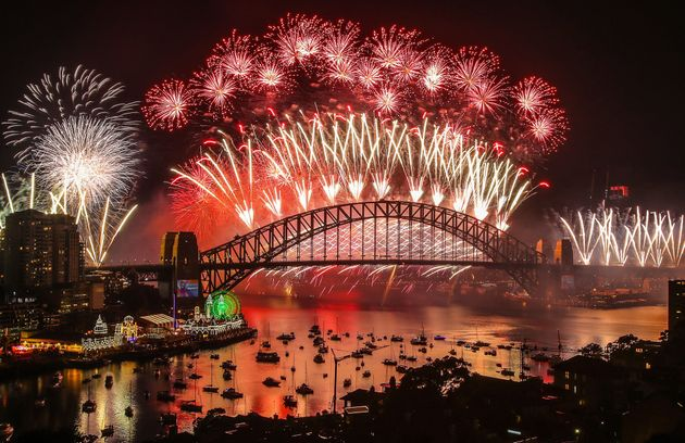 SYDNEY, AUSTRALIA - JANUARY 01: Fireworks explode over the Sydney Harbour Bridge during the midnight...