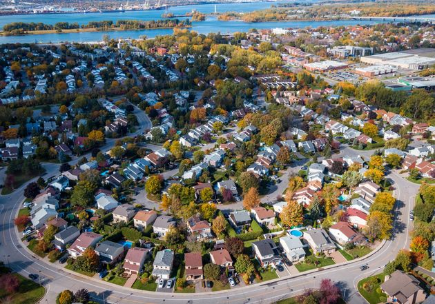 An aerial view of a neighbourhood of single-family homes in suburban Montreal. Canadian policymakers...